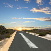 Empty countryside road with white arrow — Stock Photo