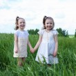 Two little sisters outdoors — Stock Photo