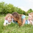 Mother with her two sons outdoors — Stock Photo