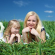 Mother with her daughter outdoors - Stock Photo