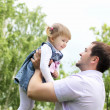 Portrait of father with daughter outdoor - Stock Photo