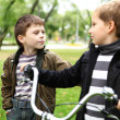 Boy on a bicycle in the green park — Stock Photo #8025539