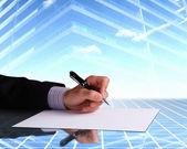Affärsman hand underteckna dokument — Stockfoto