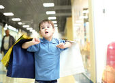 Little boy doing shopping — Stock Photo