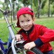 Royalty-Free Stock Photo: Boy on a bicycle in the green park