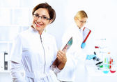 Scientists in laboratory — Stock Photo