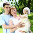 Young family together in the park — Stock Photo #8196348