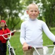 Boy on a bicycle in the green park — Stock Photo #8243919