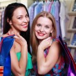 Young women with shopping bags - Stock Photo