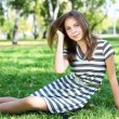 Young woman in summer park — Stock Photo
