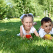 Stock Photo: Little brother and sister in summer park