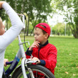 Boy on a bicycle in the green park — Stock Photo #8245312