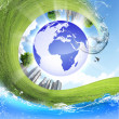 Green planet against blue sky and clean nature - Stock Photo