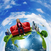 Young woman sitting on sofa nature background — Stok fotoğraf