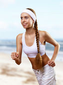 Young pretty woman in sport wear — Stock Photo