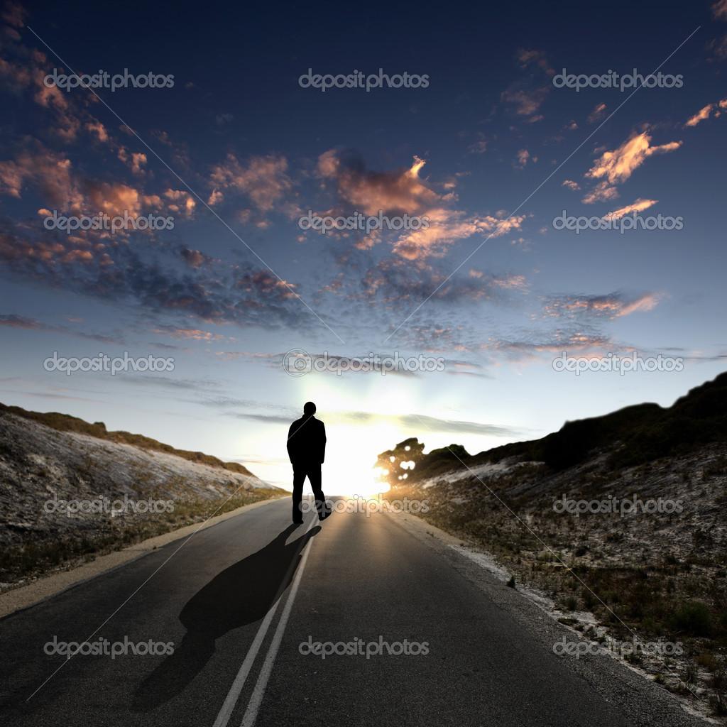 Images Of Man Walking Away At Dawn Along Road Stock Sergey