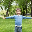Portrait of a little boy outdoors - Stock Photo