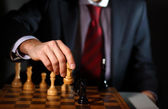 Businessman playing chess — Stock Photo