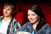 Young couple in cinema watching movie — Stock Photo