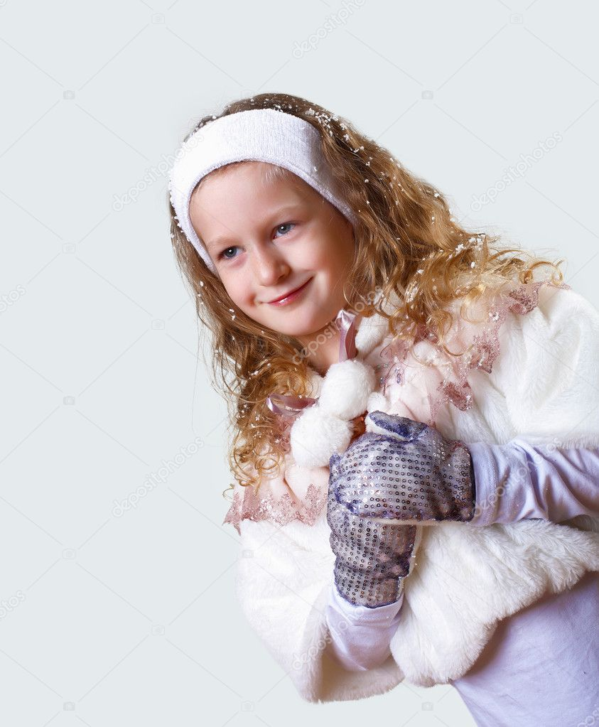 Cuty little girl in winter wear happy about new year — Stock Photo #8360175