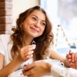 Young couple with engagement ring in a restaurant - Photo