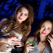 Young woman in night club with a drink — Stock Photo #8384446