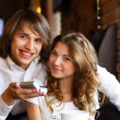 Royalty-Free Stock Photo: Young couple with engagement ring in a restaurant