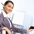 Young woman in business wear working in office — Stock Photo #8384543