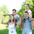 Family with two children in the summer park — Stock Photo