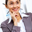 Young woman in business wear working in office - Stock Photo