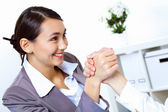 Young women arm wrestling in office — Stock Photo