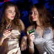 Young woman in night club with a drink — Stock Photo #8395417