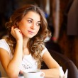 Young pretty woman sitting in restaurant — Stock Photo #8395754