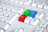 Computer keyboard with checkmark symbol — Stock Photo