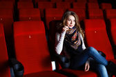 Young girl in cinema watching movie — Photo