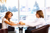 Young couple having a date in restaurant — Stock Photo