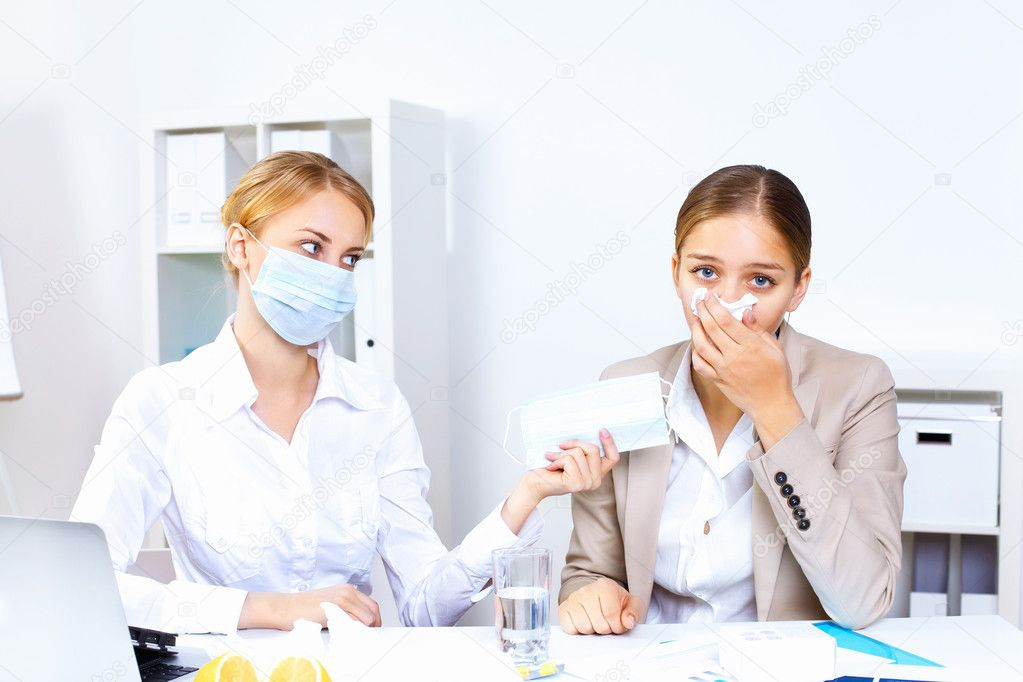 Young woman feeling unwell and sick in office  Stock Photo #8395659