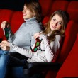 Young couple in cinema watching movie - Stock Photo