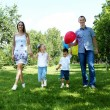 Stock Photo: Family with two children in summer park