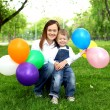 Mother with her son outside — Stock Photo #8417776