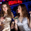 Young woman in night club with a drink — Stock Photo #8418031