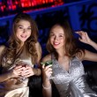 Young woman in night club with a drink — Stock Photo