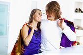 Young couple doing shopping together — Stock Photo