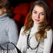Young couple in cinema watching movie — Stock Photo #8436449