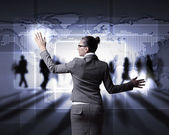 Businesswoman working with virtual computer screen — Stock Photo