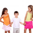 Two girls and a boy together in studio — Stock Photo