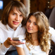 Young couple with engagement ring in a restaurant — Stock Photo
