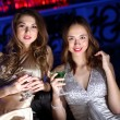 Young woman in night club with a drink — Stock Photo #8460141