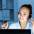 Young female with headset - Stock Photo