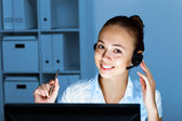 Young female with headset — Stock Photo